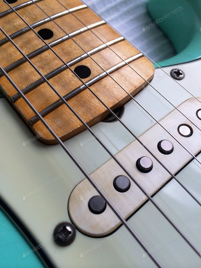 Close-up of a 60's Stratocaster-style guitar that I built from an alder body and maple neck.