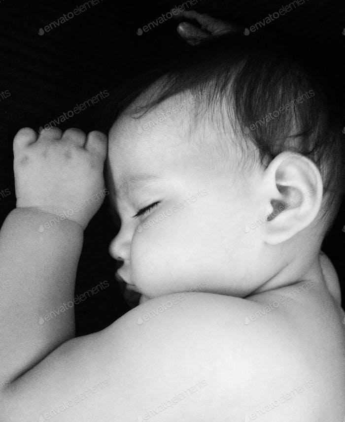Black and white photo of sleeping chunky baby