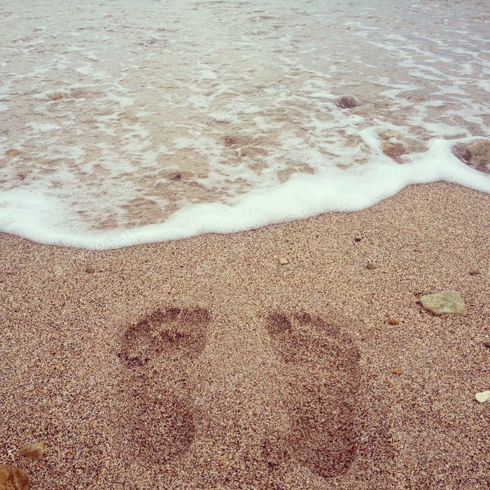footprints on the beach in Mexico