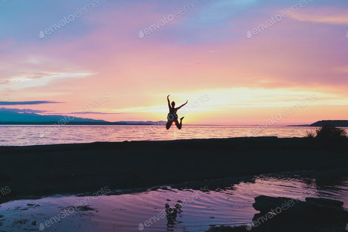 Girl jumping up in the air