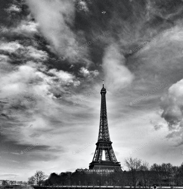 Eiffel Tower symbol of Paris, look at that plane just above the tower travel and journey in the city