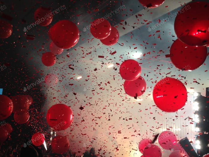 Balloons and ticker-tapes during live concert in stadium