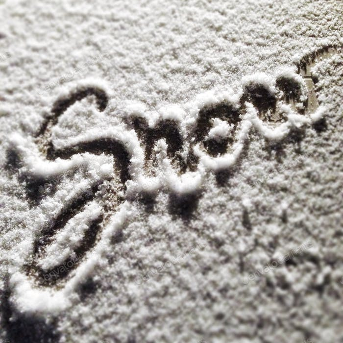 'Snow' written in snow