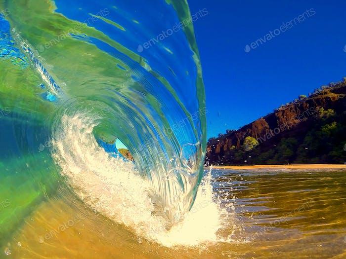 Wave crashing along the beach