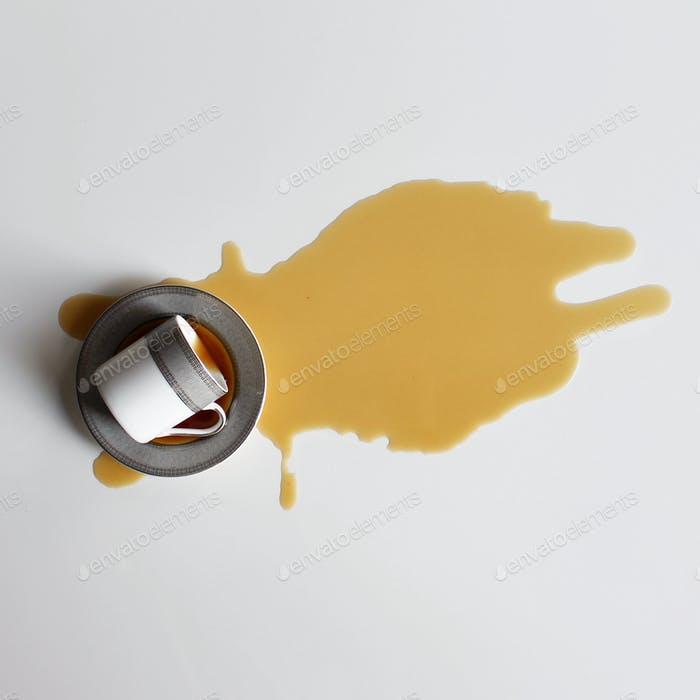 Tea spilled on white background