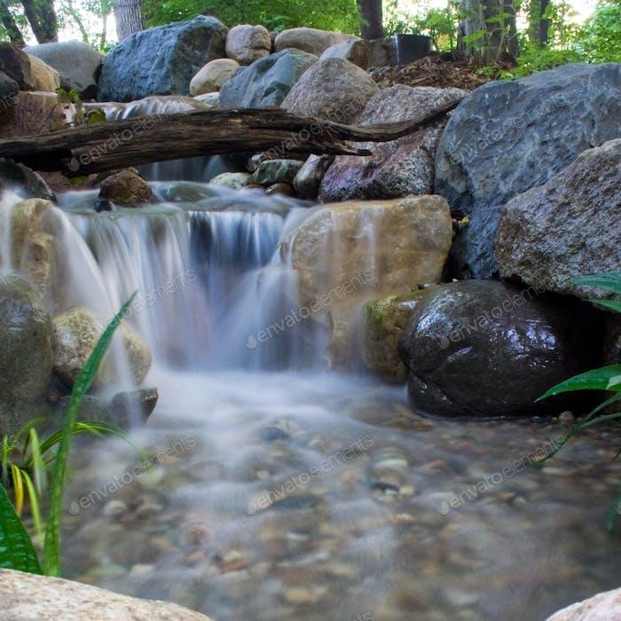 Beautiful waterfall in the backyard of a house