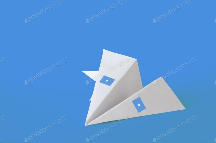 Somalia flag depicted on paper origami airplane. Oriental handmade arts concept