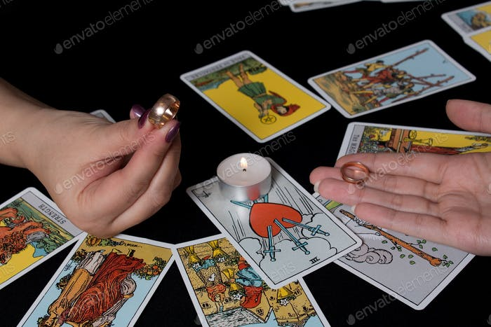 Gypsy lays out Tarot cards and wonders for the future