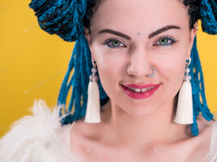 Glamour portrait of sexy woman with african blue braids hairstyle