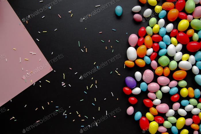 Colorful bonbons candies on the black background