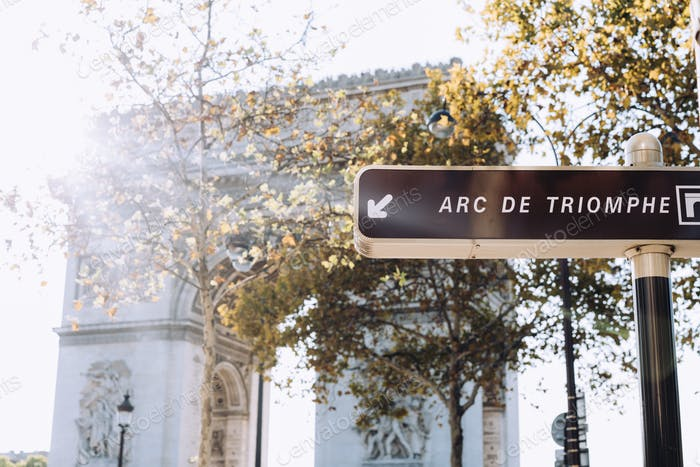 Paris landmark Arc de Triomphe and sign pointing to it