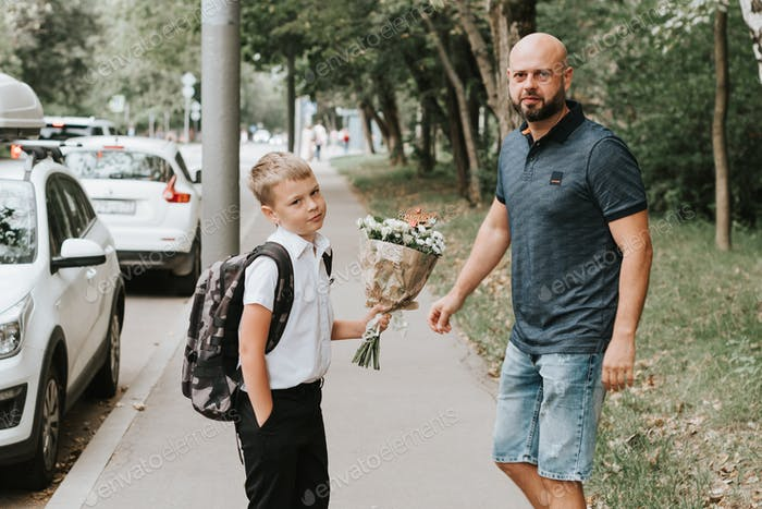 Father see off his son to school