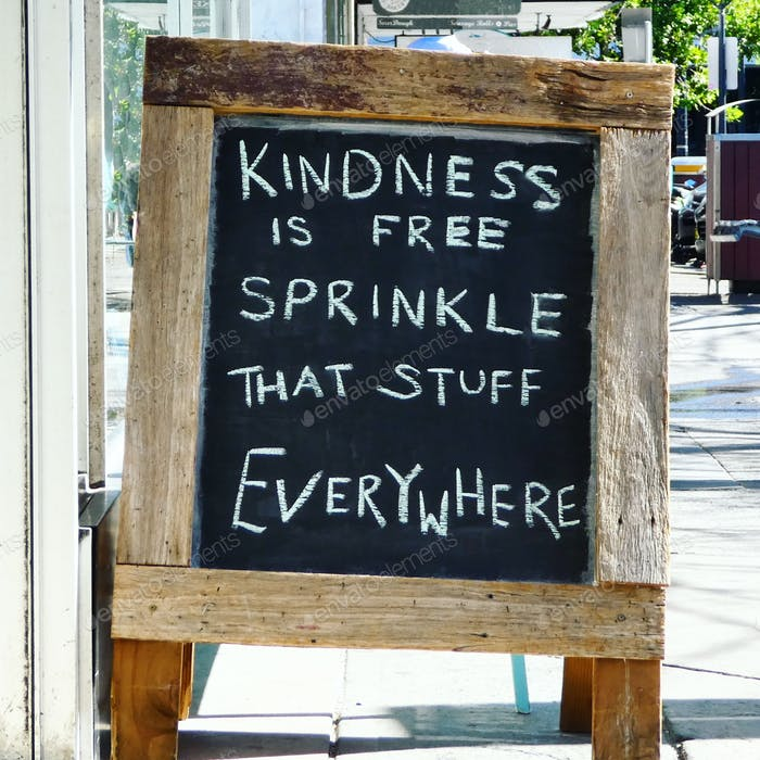 Street view,chalkboard sign on wooden frame with kindness quote