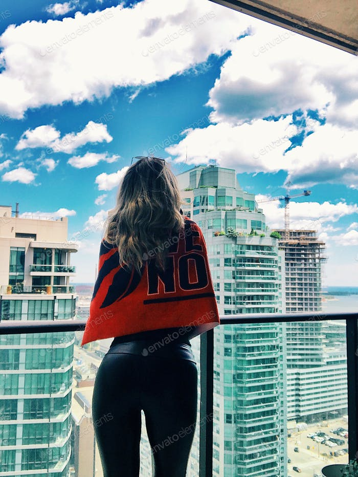 A girl from behind with Raptors flag