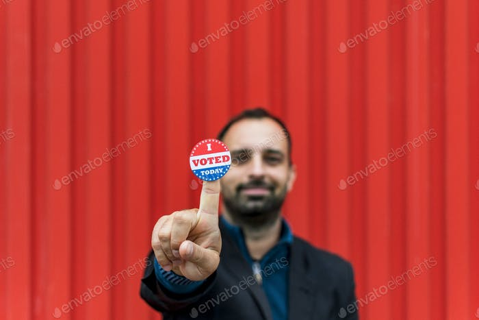 Man holding voting sticker, i voted, election, voting, presidential election, usa, election 2020.