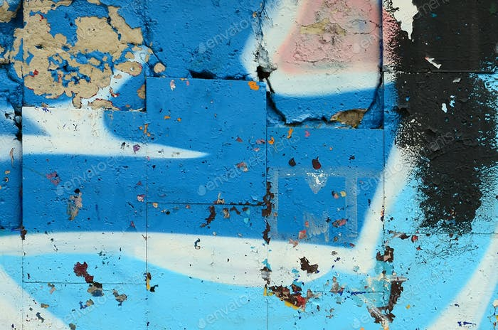 Arte callejero. Imagen abstracta de fondo de un fragmento de una pintura de graffiti coloreada en tonos azules.