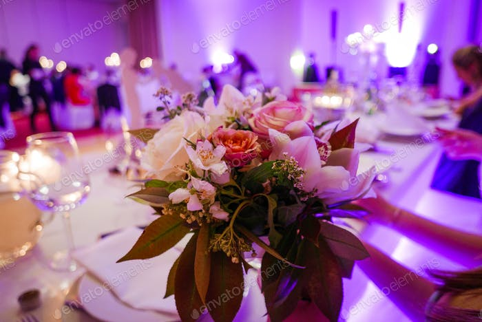 Closeup shot of a wedding bouquet. Bouquet of flowers on a table. Focus on foreground.