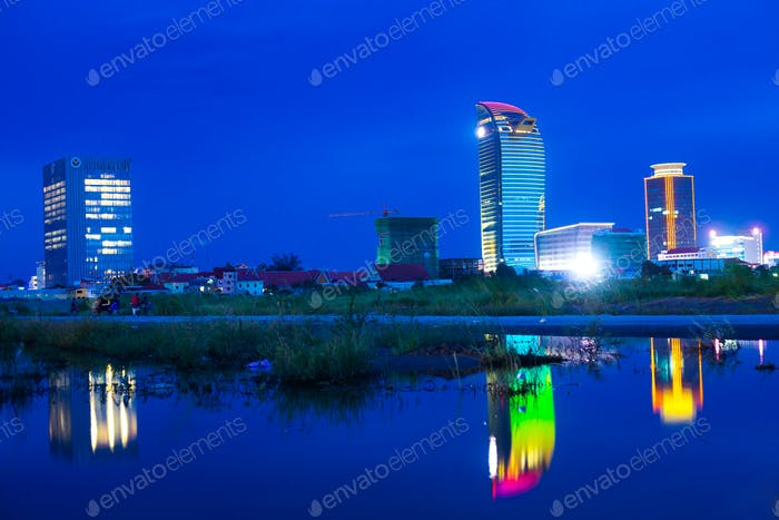 The Unique Building In Phnom Penh reflection in the water.