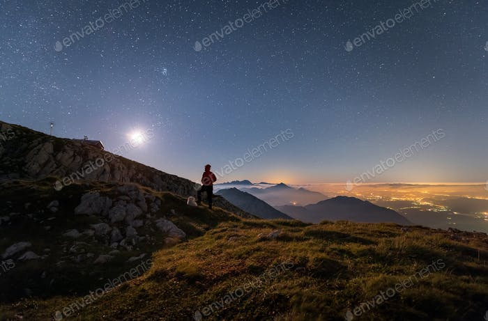 Man and dog posing under the Starry night when the moon rises. This is a self portrait of me and my