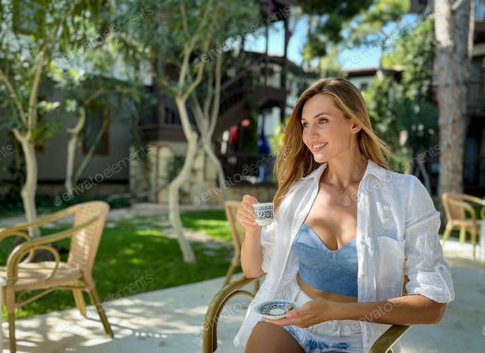 Beautiful woman drinking Turkish coffee