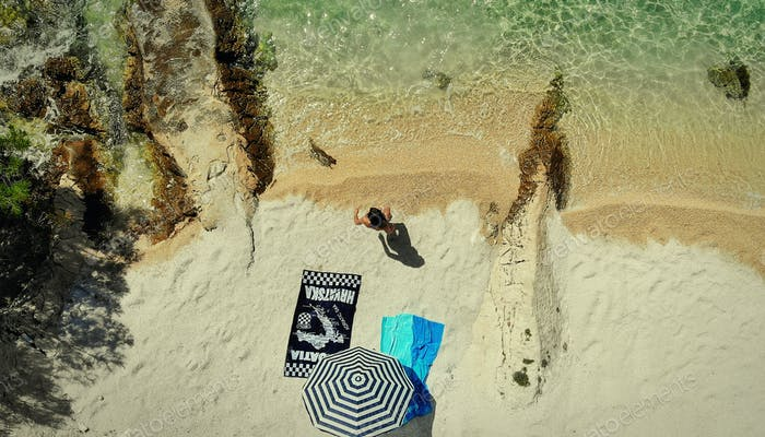 A view of a woman on abeach seen from above