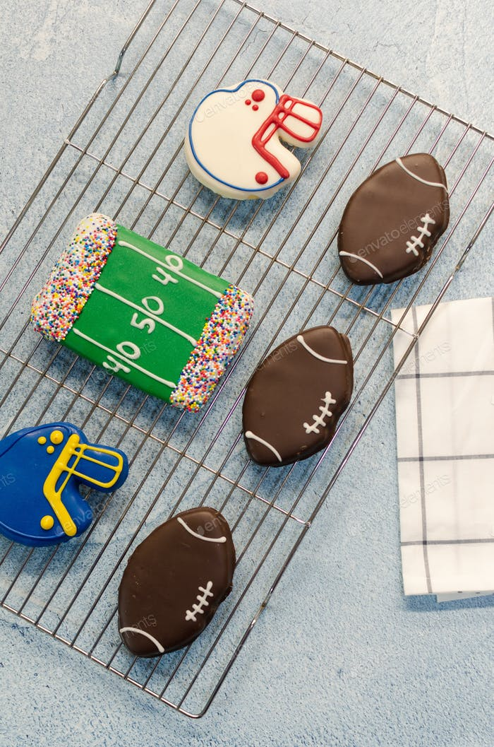 Football themed iced cookies freshly baked for the super Bowl