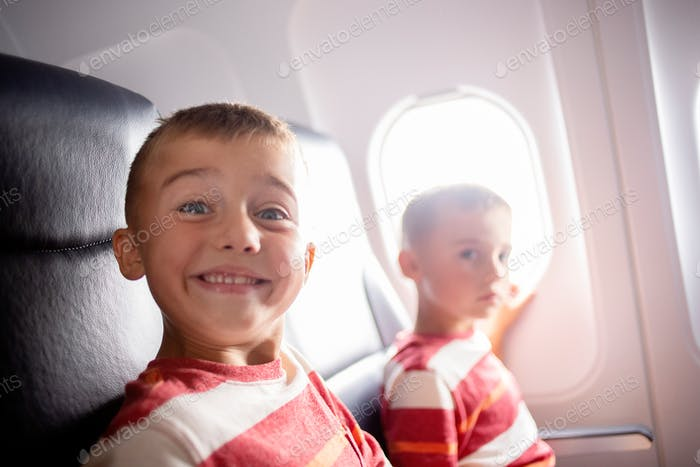 On an airplanes young boys