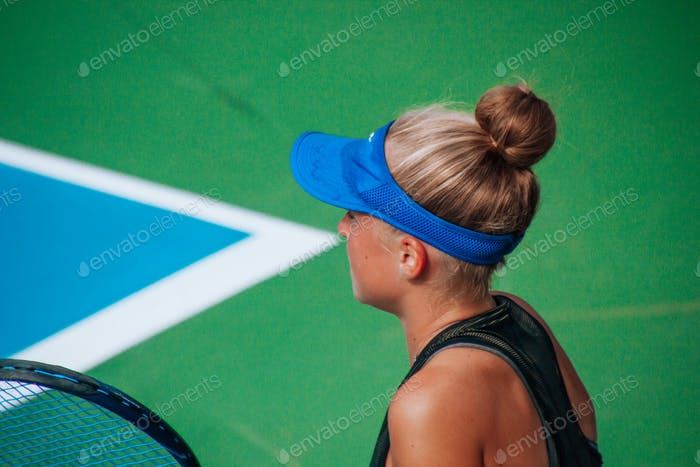close up portrait of girl playing tennis