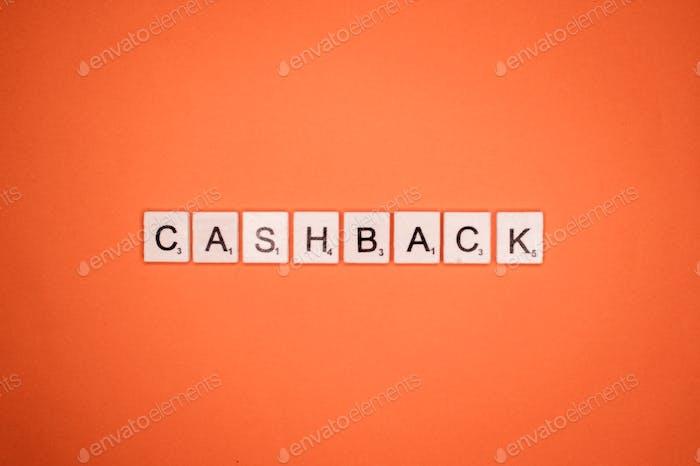 Cashback scrabble letters word on a orange background
