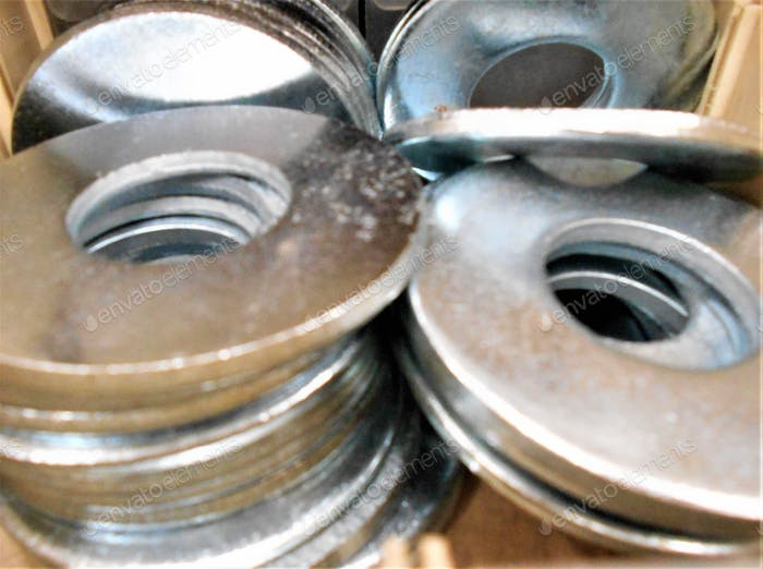 Just Washers! Minimalism with a pile of shiny washers for a building project.