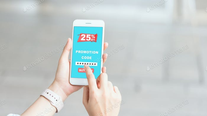 Women holding the smartphone to enter the code to get a discount from the store.