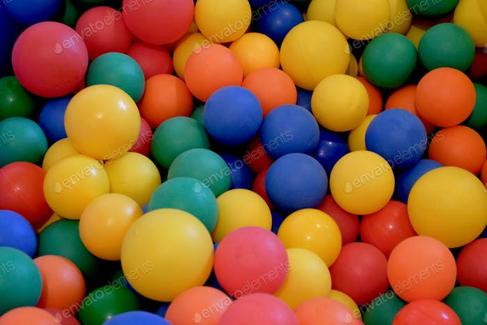 Play with small colorful balls.