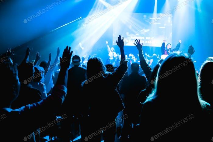 People worshipping Jesus in church