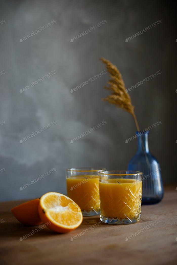 Still life with orange and orange juice