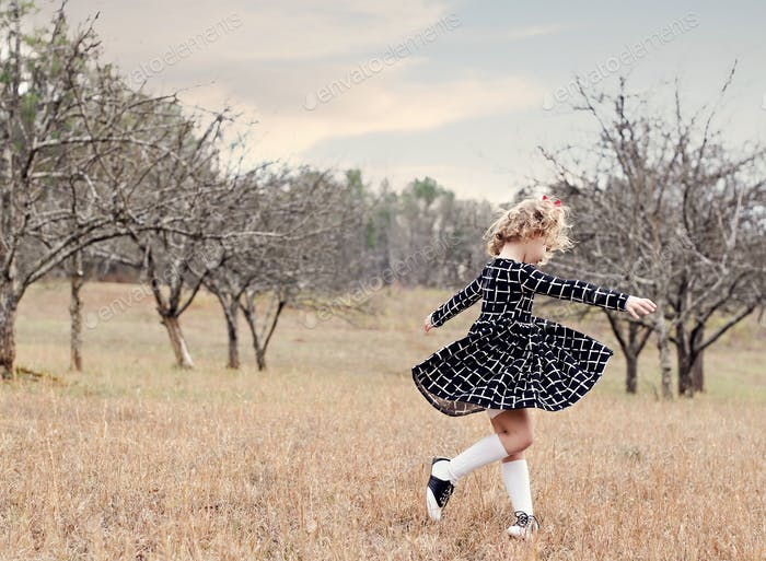 Little girl dancing and Twirling