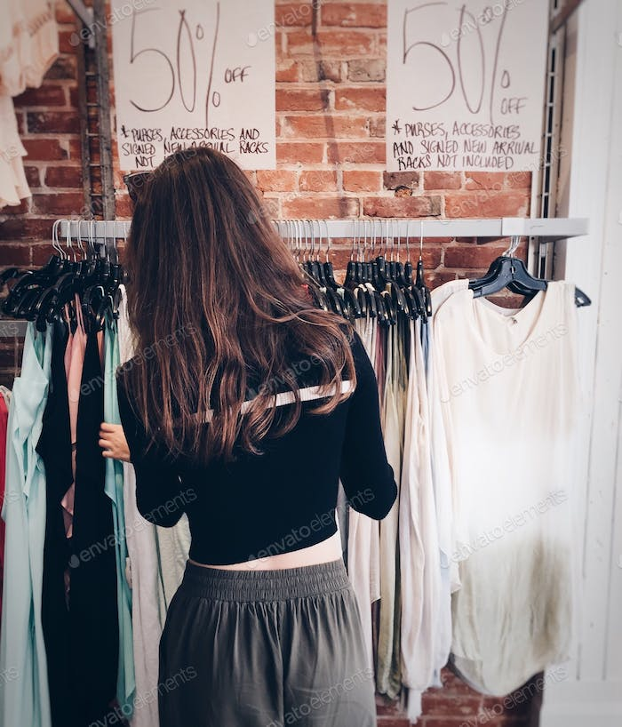 Girl shopping in a retail clothing store