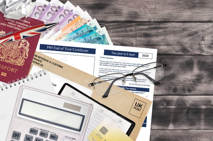 English Tax form P60 End of year certificate by HM revenue and customs lies on table with office