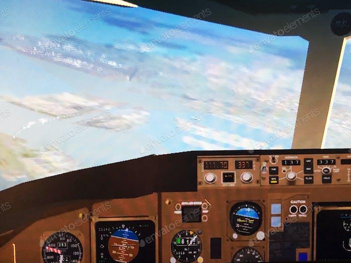 Cockpit view in airplane simulator game arcade, Tokyo.