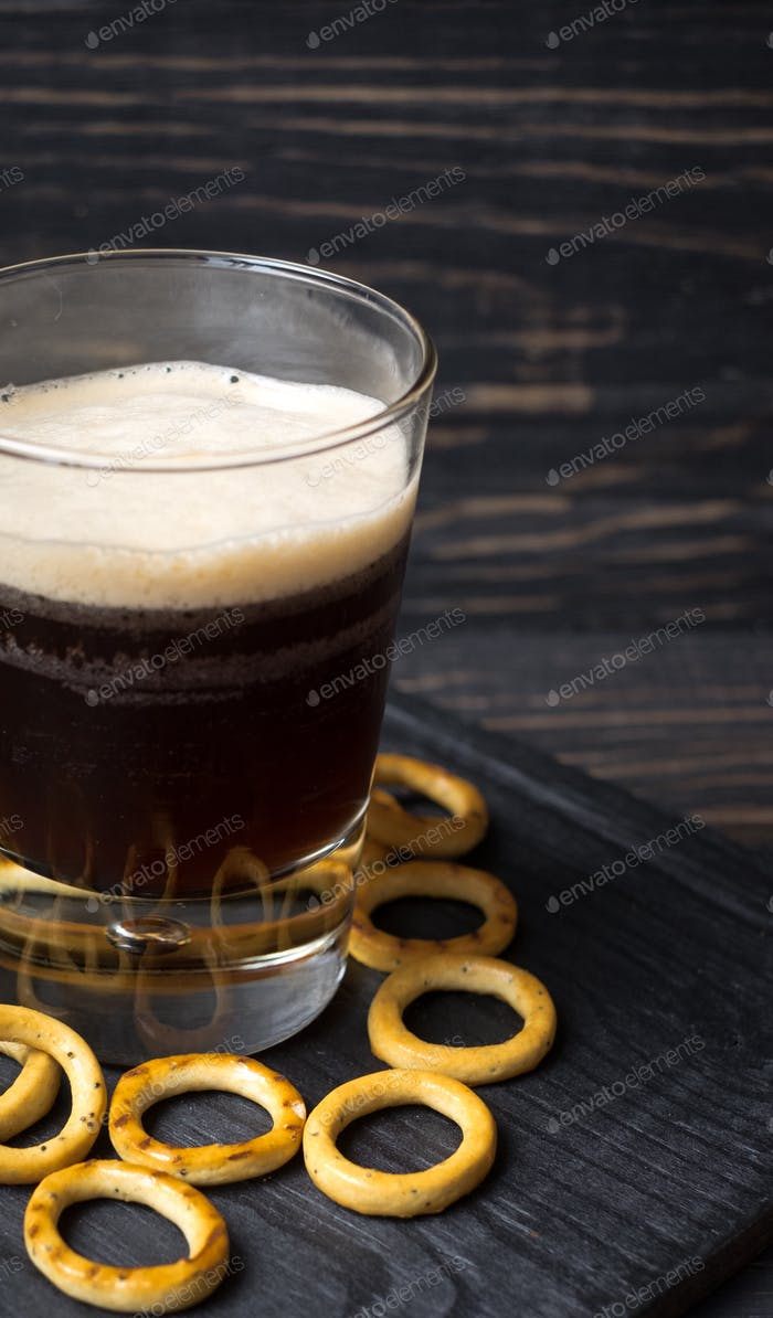 Dark beer in a glass and savory cookies