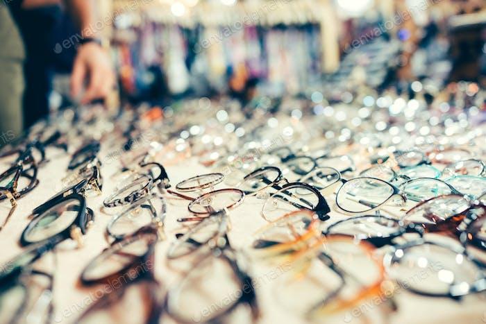 Hundreds of glasses for sale at a flea market.