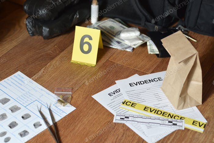 Evidence Chain of Custody Labels and brown paper bag with fingerprints applicant card lies against