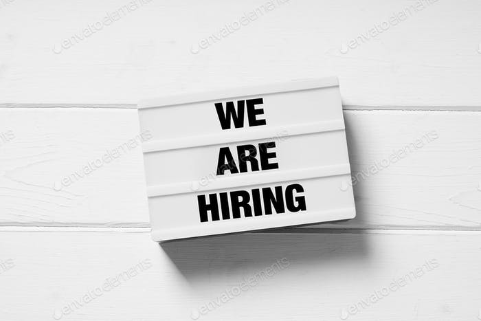 we are hiring text on light box sign as minimalist employment and recruitment concept