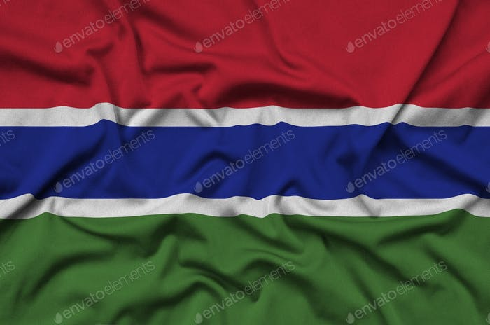 Gambia flag  is depicted on a sports cloth fabric with many folds. Sport team waving banner