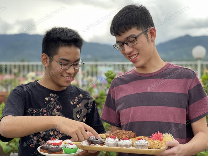 Asian youth happily sharing their food
