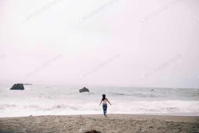 Running towards the waves at Sonoma Coast