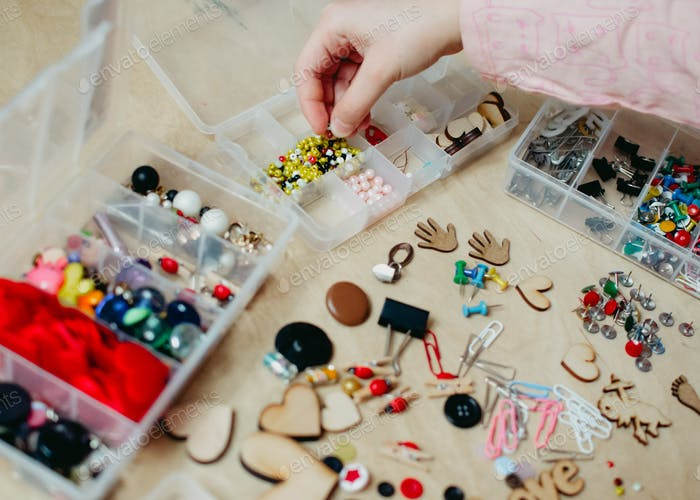 girl arranges beads in an organizer, organizing, crafting, Competent organization of the house