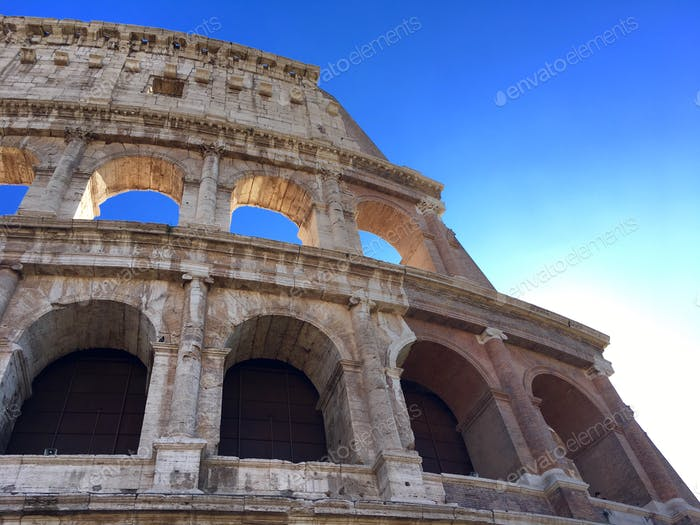 Blue sky through the ancient Colosseum in Rome