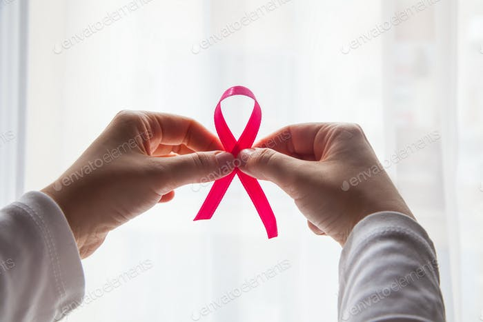 Hands Holding pink ribbon with white background