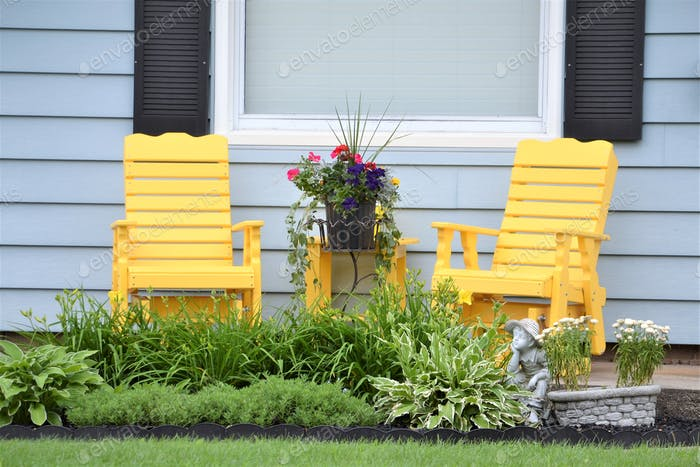 Front porch living space with yellow chairs!
