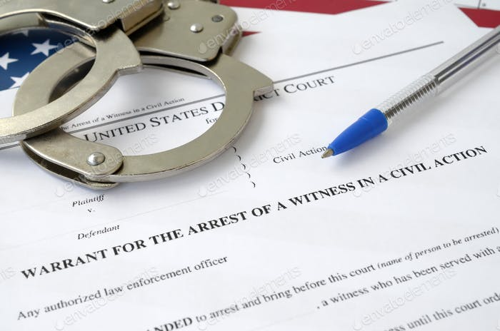 District court warrant for the arrest of a witness in a civil action papers with handcuffs and blue